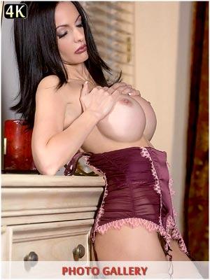 Catalina Cruz in her bedroom in sexy corset lingerie